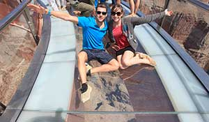 Sitting on glas on Grand Canyon Skywalk