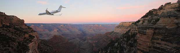 Airplane flying in the Grand Canyon at dusk